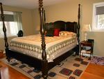 Large Master Bedroom with hardwood flooring, walk in closet and full ensuite!