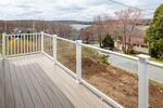 Imagine relaxing with a glass of wine to enjoy the beautiful sunsets on the front balcony made of composite decking
