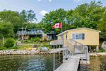 Taken from the dock the boathouse is perfect for entertaining by the water and the main retreat lies just beyond.